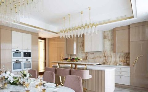 A Luxury Kitchen Where Gold and Coral Create a Stunning Environment